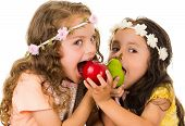 pic of healthy eating girl  - Beautiful healthy little girls eating delicious fresh fruits isolated on white - JPG