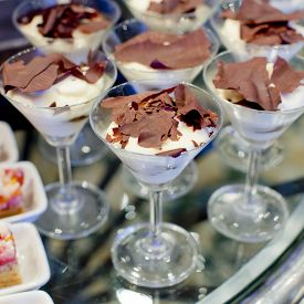 picture of buffet catering  - Gourmet catering for a special occasion with a buffet table filled with a selection of individual desserts