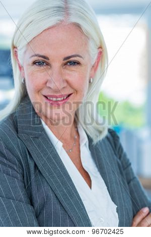 Serious businesswoman looking at camera in office