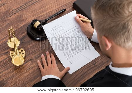 Judge Reading Paper In Courtroom