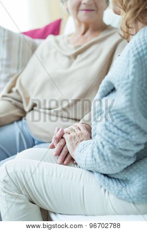 Woman Holding Aged Female