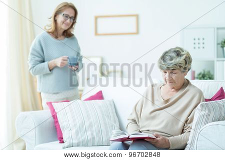 Senior Woman Relaxing On Sofa