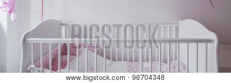 White Crib In Baby Room