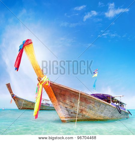 Traditional wooden boat in Thailand near Phuket island. Adventure trip background