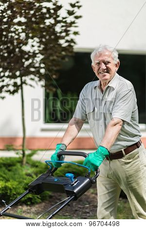 Elder Gardener With Lawn Mower