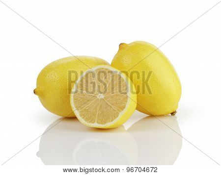 two and a half fresh ripe lemons isolated on white