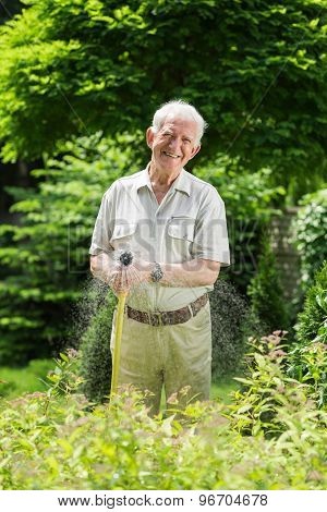 Watering Grass With Garden Hose