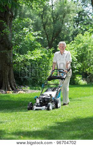 Elder Gardener Mowing Lawn