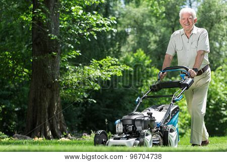 Landscape Worker Mowing Grass