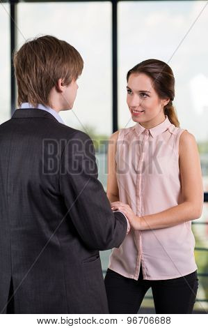 Businesswoman Flirting With Coworker
