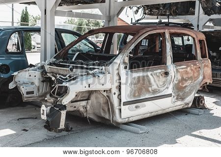 Rusted torched car