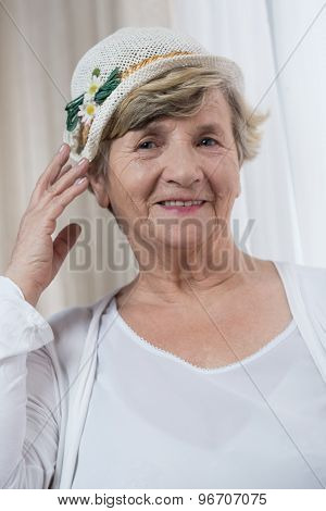 Pensioner Trying On A Hat