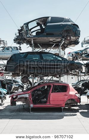 Crashed cars in dismantling yard.