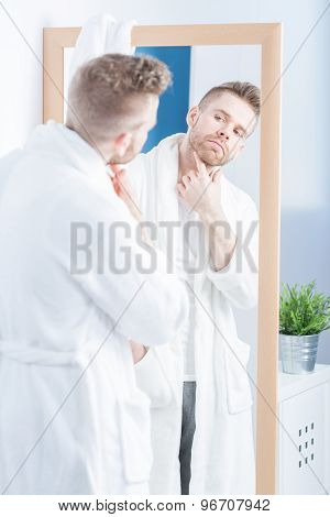 Admiring Himself In Mirror