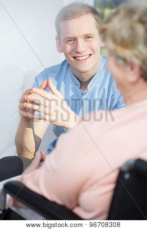 Man Giving Support To Older