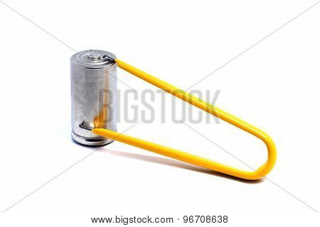 Yellow Tweezers And A Large Battery On A White Background