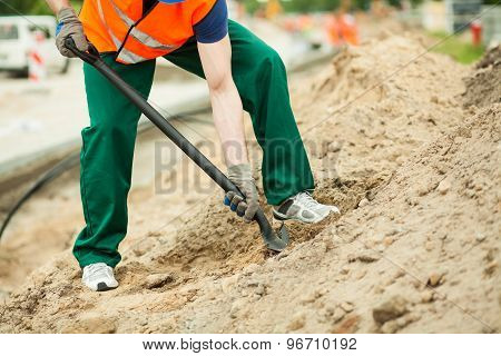 Construction Worker Using Spade