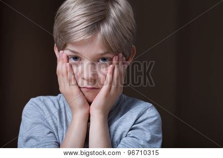 Kid Holding Face Between Hands