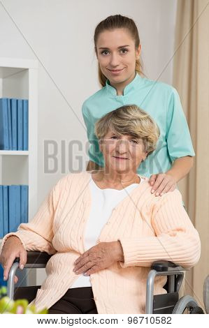 Elderly Woman Sitting On Wheelchair