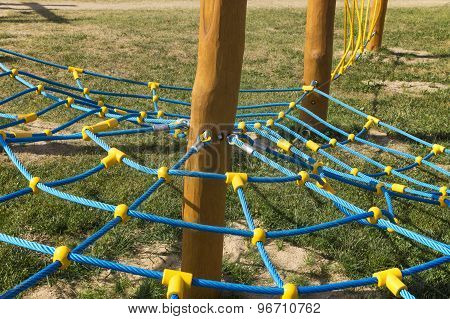 Rope Climbing Frame In The Shape Of Cobwebs On The Playground