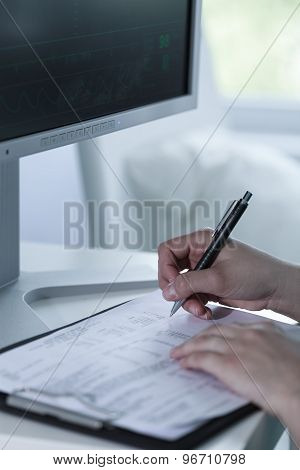 Doctor Looking At Medical Monitor