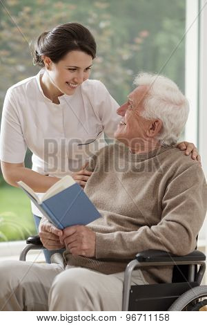 Caring Nurse Talking With Patient