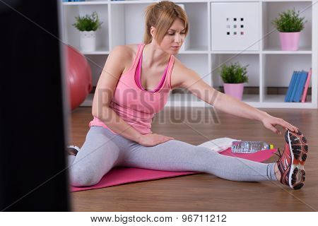 Stretched Woman Doing Exercise