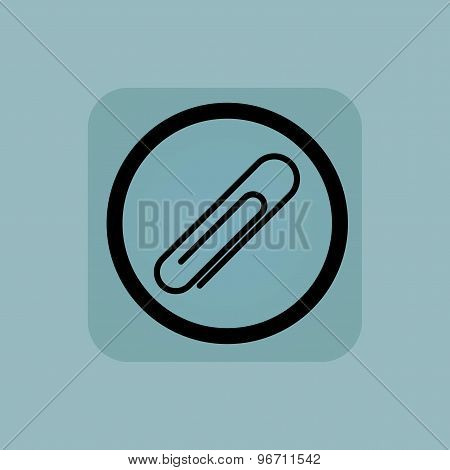 Pale blue paperclip sign