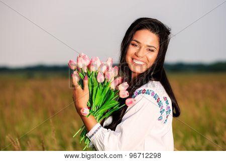 beauty Girl Outdoors enjoying nature. Beautiful Teenage Model girl in white dress