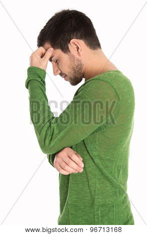 Pensive or depressive isolated man in green pullover.