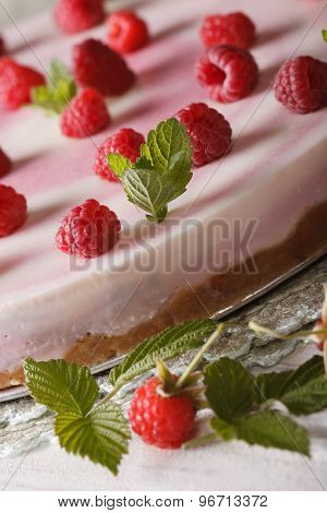 Raspberry Cheesecake With Mint Macro On The Table. Vertical