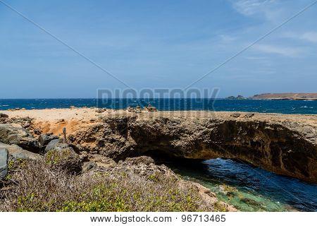 Natural Bridge Over Deep Blue Sea