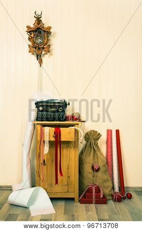 Old and nostalgic decoration for christmas in red and brown colors with cuckoo clock.