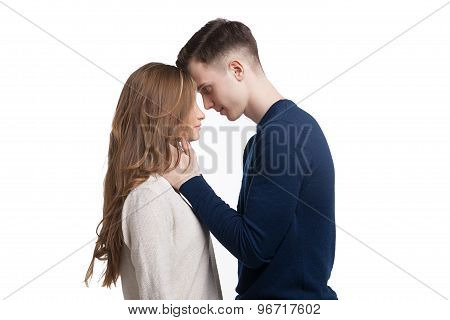 Young couple in love isolated on white background
