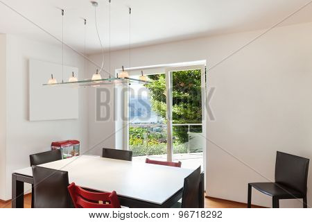 Interior of apartment, modern dining room, white wall