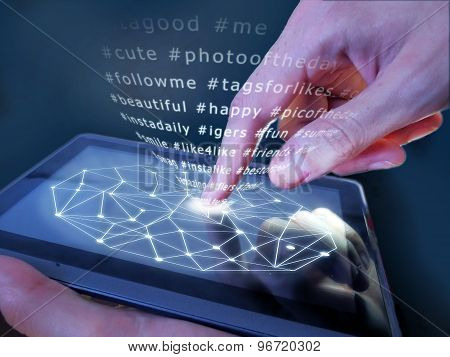 The hand presses the button on the touch screen interface
