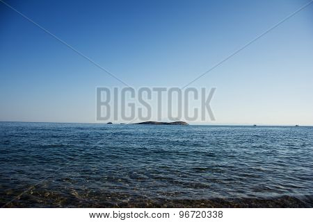 Blue Waters With Island In The  Middle Of The Sea