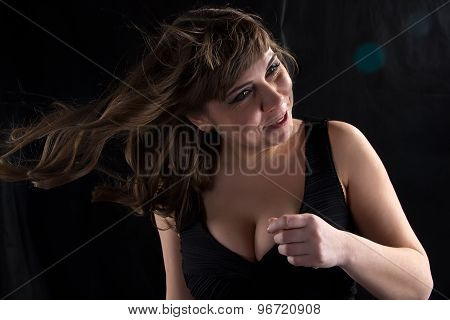 Image of curvy woman with flowing hair