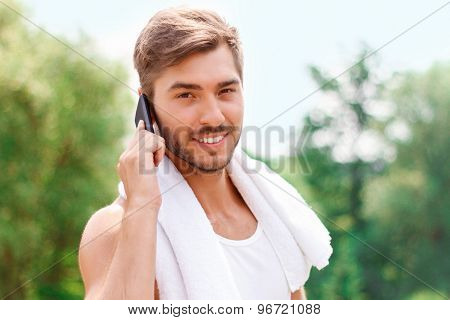 Smiling guy talking on phone