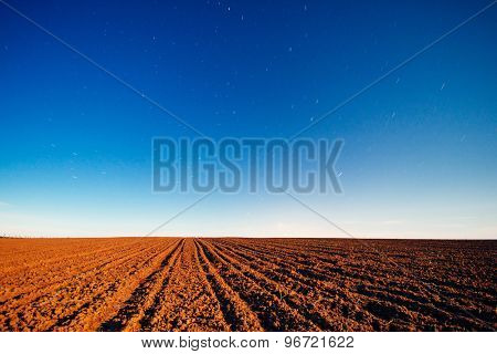 Night sky over agricultural field