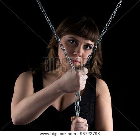 Photo of curvy woman squeezed chains