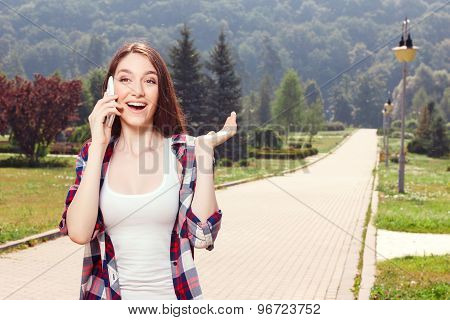 Pretty girl holding mobile phone