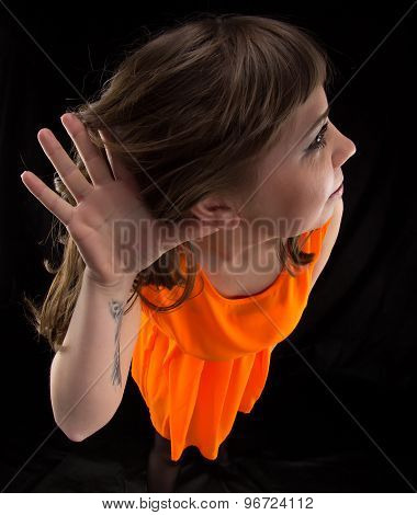 Photo of listening woman in orange dress