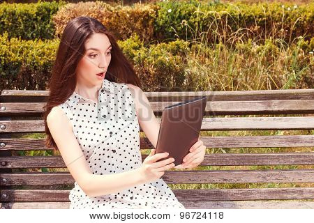 Nice young girl holding laptop