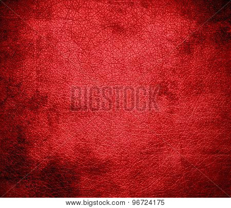 Grunge background of deep carmine pink leather texture