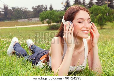 Pleasant girl listening to music