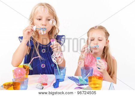Children blowing soap bubbles