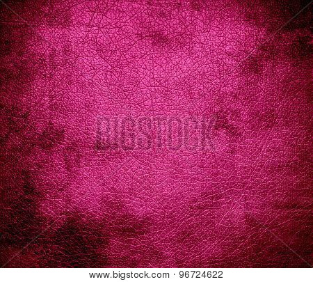 Grunge background of deep cerise leather texture