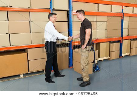 Manager And Worker Shaking Hands