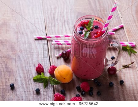 Smoothie With Summer Berries And Fruits In A Glass Mug On The Wooden Table